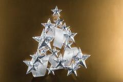 Estrelas efervescentes e fita de prata Fotografia de Stock