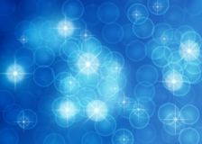 Estrelas, luzes, Sparkles e bolhas brilhantes abstratos no fundo azul ilustração royalty free