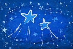 Estrelas no papel azul fotografia de stock