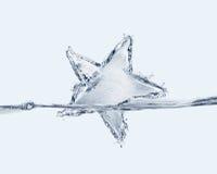 Estrella caida en agua Fotos de archivo