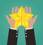 Estrella de Hands Giving Gold del hombre de negocios Imágenes de archivo libres de regalías