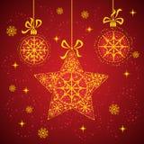 Estrella de la Navidad con los copos de nieve rojos. imagen de archivo