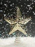 Estrella de la Navidad con nieve que cae Foto de archivo