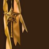 Estrella de la Navidad del oro con las cintas Fotografía de archivo libre de regalías