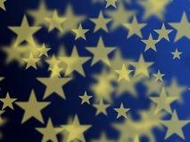 Estrella de oro con el fondo azul Imagen de archivo libre de regalías