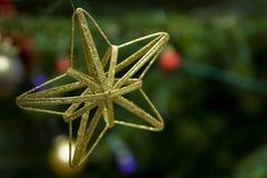 Estrella de oro de la Navidad Imágenes de archivo libres de regalías