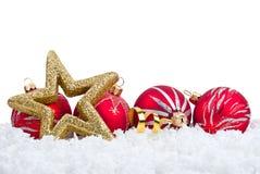 Estrella del oro y decoración roja de la Navidad de la bola Fotografía de archivo