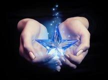 Estrella en las manos Fotografía de archivo libre de regalías
