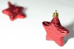Estrella roja para el fondo de la Navidad Fotos de archivo