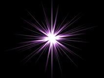 Estrella violeta en un fondo negro. Fotografía de archivo libre de regalías