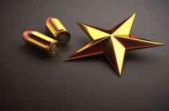 Estrella y munición del oro fotos de archivo libres de regalías
