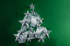 Estrellas chispeantes y cinta de plata Fotografía de archivo