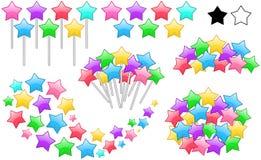 Estrellas coloridas en los palillos fijados Imagen de archivo libre de regalías