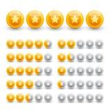Estrellas de clasificación en esferas brillantes del oro Foto de archivo
