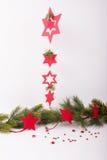 Estrellas de la Navidad con la rama del abeto Imagen de archivo