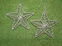 Estrellas de plata de la Navidad Fotos de archivo