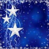 Estrellas de plata de la Navidad en fondo azul Imagen de archivo