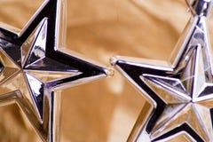 Estrellas de plata ornamentales Fotografía de archivo