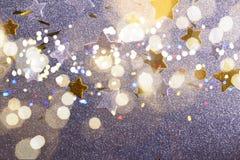 Estrellas de plata y de oro de la Navidad Imagenes de archivo