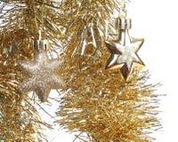 Estrellas del juguete de la Navidad del oro y oropel chispeante Fotos de archivo