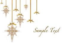 Estrellas del ornamento de la Navidad que cuelgan de cinta y de B Imagen de archivo