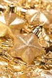 Estrellas del oro de la Navidad Fotos de archivo
