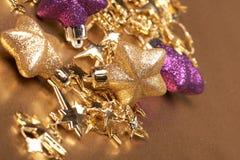 Estrellas del oro de la Navidad Imagenes de archivo