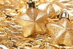 Estrellas del oro de la Navidad Imagen de archivo libre de regalías