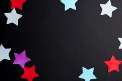Estrellas del papel de diversos colores Foto de archivo
