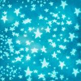 Estrellas en el papel arrugado azul Imágenes de archivo libres de regalías