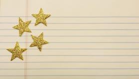 Estrellas en el papel del cuaderno Fotos de archivo