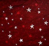 Estrellas en el papel rojo Fotos de archivo libres de regalías