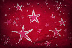 Estrellas en el papel rojo Imagen de archivo