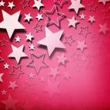 Estrellas en fondo rosado imagenes de archivo