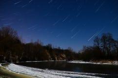 Estrellas fugaces de la noche Fotos de archivo