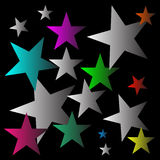 Estrellas multicoloras con el fondo negro Fotografía de archivo libre de regalías