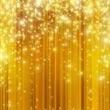 Estrellas que descienden en fondo de oro Imagen de archivo