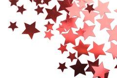 Estrellas rojas del día de fiesta aisladas Foto de archivo