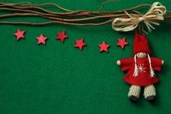 Estrellas y ángel en fondo del fieltro Foto de archivo