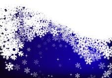 Estrellas y copos de nieve en fondo del cielo azul Fotografía de archivo libre de regalías