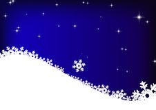 Estrellas y copos de nieve en fondo del cielo azul Fotografía de archivo