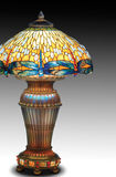 Estremely Rare Tiffany Lamp with Dragonflies. Tiffany Table Lamp with guilded base Royalty Free Stock Photography