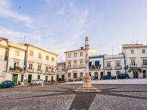 Central square of Estremoz with a marble pillory in Manueline st. ESTREMOZ, PORTUGAL – AUGUST 23, 2018: Central square of Estremoz with a marble pillory royalty free stock photos