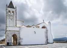 Estremoz white chapel. Rainha Santa Isabel Chapel in Estremoz under a heavy overcast sky. Alentejo, Portugal Royalty Free Stock Image
