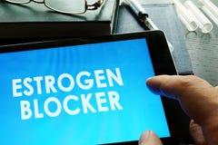 Estrogen blocker on a tablet. Estrogen blocker. Doctor holding tablet with sign stock images