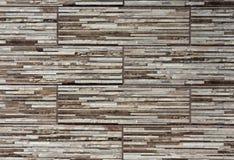 Estructura estilizada de la pared con las piedras marrones y grises Fotos de archivo