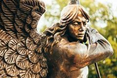 Estátua da igreja Católica vermelha de Michael With Outstretched Wings Before do arcanjo de St Simon And St Helena Fotografia de Stock Royalty Free