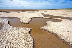 Estuaire de marée Mudflats, Norfolk, Angleterre Photographie stock