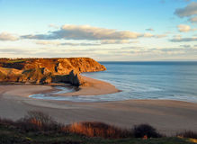Estuary. Three cliffs bay, south wales, near sunset stock image