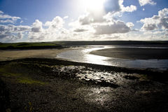 Estuary at low tide. Low tide in the estuary at Rock with a bright reflection and interesting sky Stock Photography